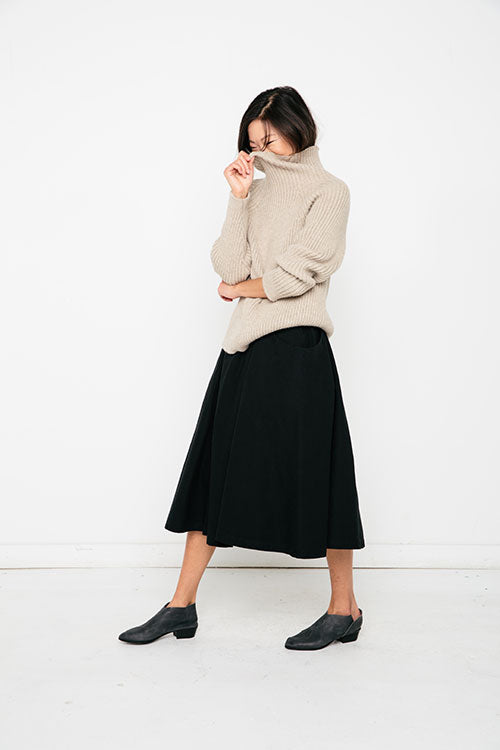 HOVER2_Meredith Turtleneck [Oyster Rib Alpaca] + Clyde Billow Skirt [Black Cotton Canvas]