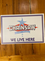 Chainsaw We Live Here Sign