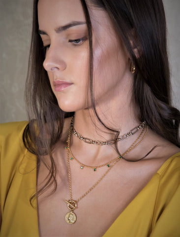 Featuring Enclance choker, Alessia emerald choker and Moneda necklace