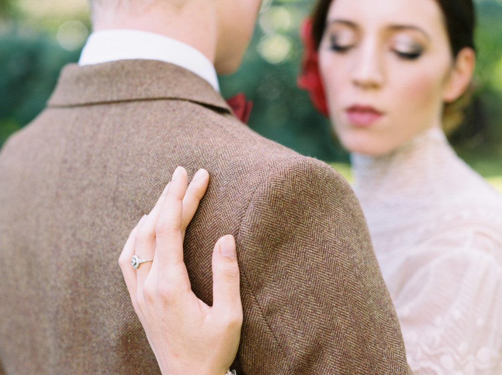 Diamond cluster engagement ring in vintage inspired photo shoot
