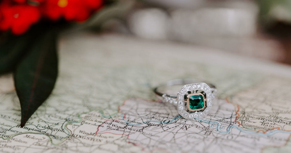 Emerald and diamond vintage style engagement ring from London Victorian Ring Co.