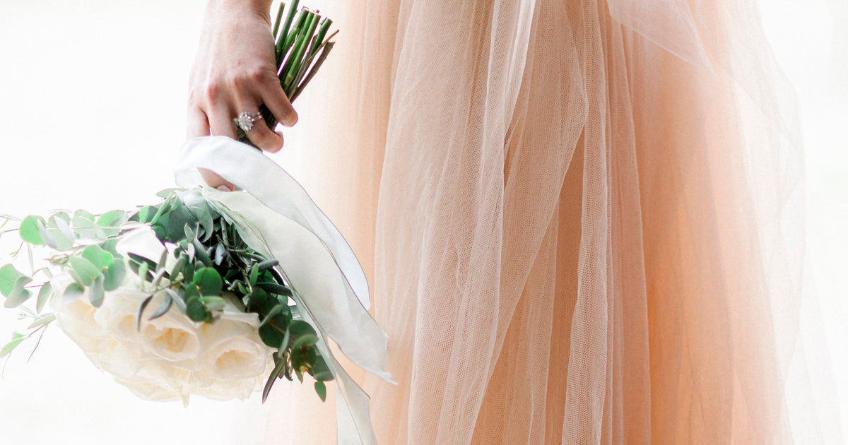 Summer Wedding Dress with Bouquet of Flowers