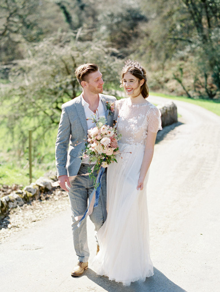 Eloping bride and groom at Boconnoc House in Cornwall