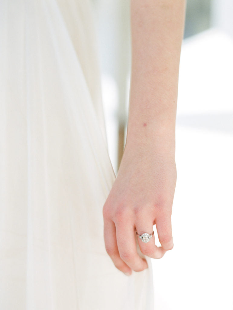 Bride wearing engagement ring before the ceremony.