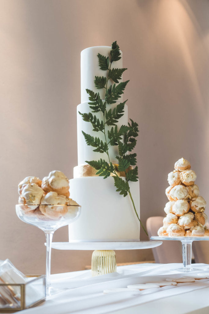Three Tier White Wedding Cake with Green, Gold and Silver Accents and Cream Puff Profiteroles