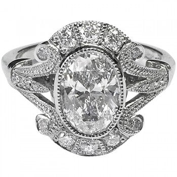 Oval cut diamond cluster ring in platinum, in an Edwardian vintage design