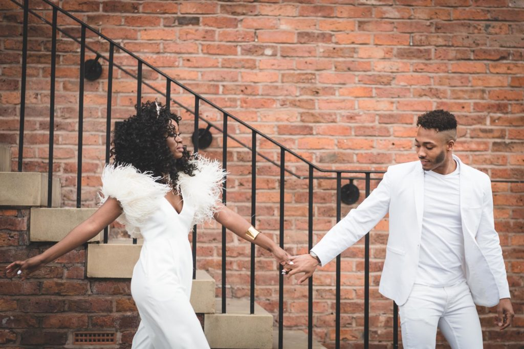 Bridal White Jumpsuit and Mono Colour Groom Outfit for a Stylish 1970s Theme Wedding