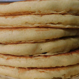 A tall stack of fresh pancakes, light and fluffy
