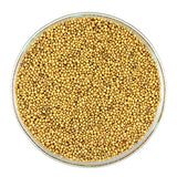 Yellow and brown mustard seeds are stone ground
