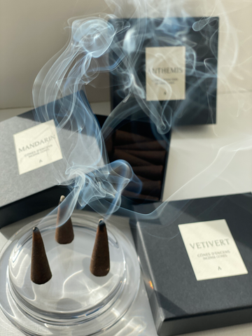 Maison Von Natural and sustainable Incense Cones lit up and smoking