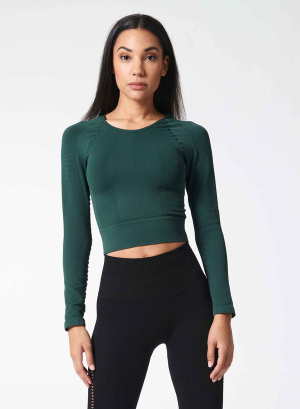 One by One long sleeve workout top in black - front view - Jaclyn Wood