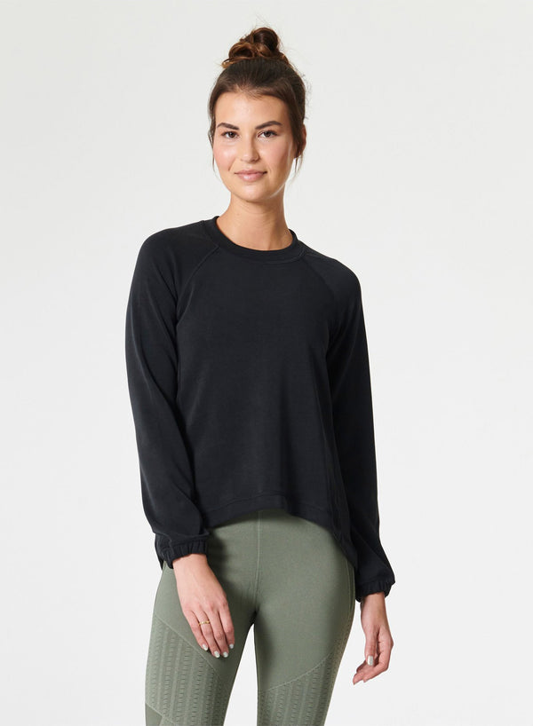Sleek sweat pullover sweater in black - front view - Jaclyn Wood