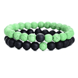 black and green distance bracelets tao