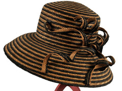 For Hat Hire 'Tracy' call 01453808201, email heidi@hatborrower.com or visit www.hatborrower.com