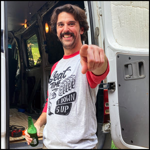 Lifestyle shot of Brian Pierce, the Purveyor of Awesome himself, showing off the One Down Five Up Raglan Shirt