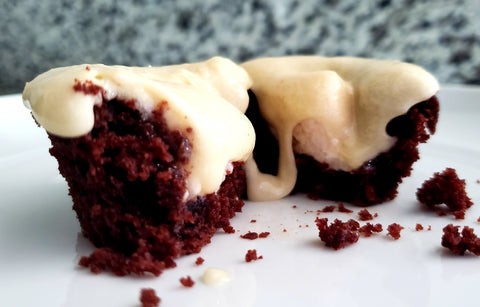 Strawberry Mellos Stuffed in Chocolate Cupcakes with Vanilla Frosting