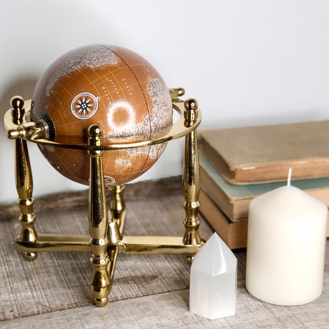 The world map globe sphere ivory brass stand