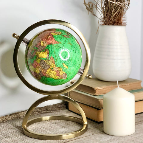 The world map globe sphere colour brass stand