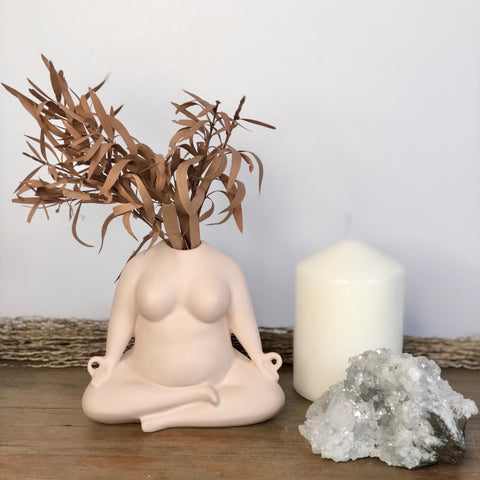 The nude meditates pottery vase