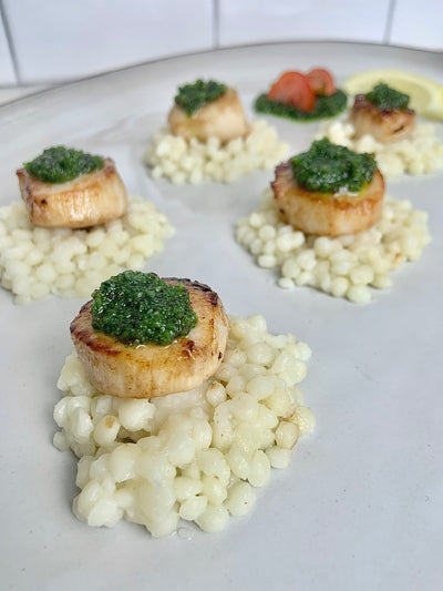 Seared Scallops with Modern Pesto over a bed of Couscous