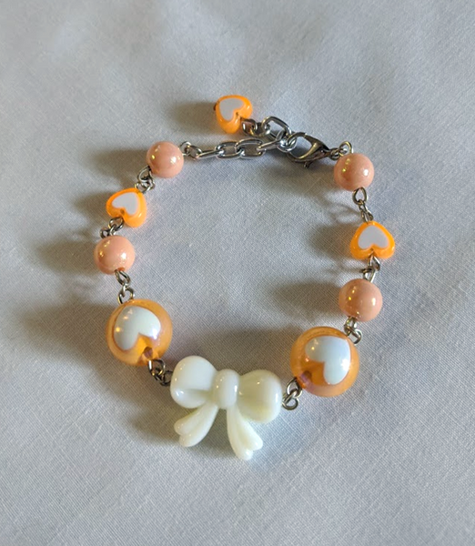 Lovely Hearts Bow Bracelet in Orange