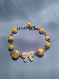 Lovely Hearts Bow Bracelet in Yellow