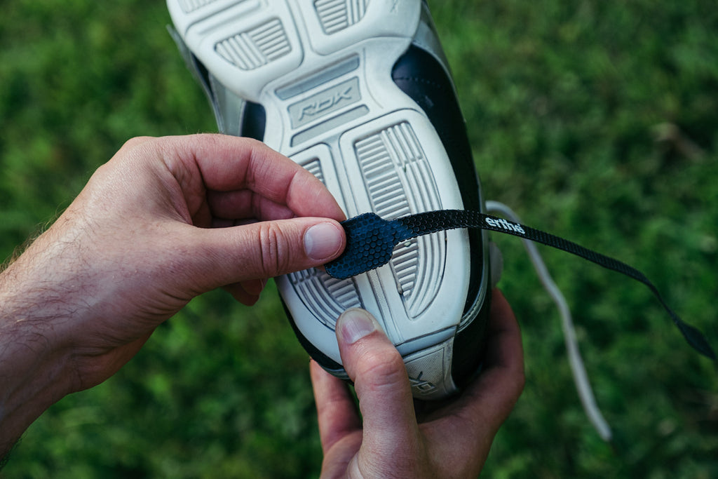 how to stick erthe straps to bottom of shoe