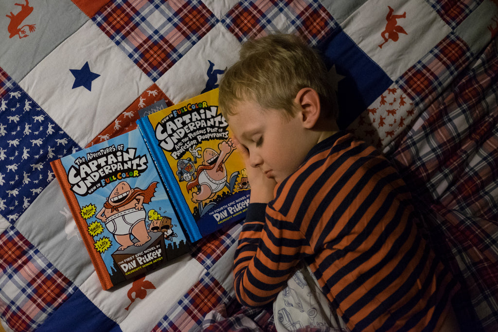 child falling asleep to reading captain underpants