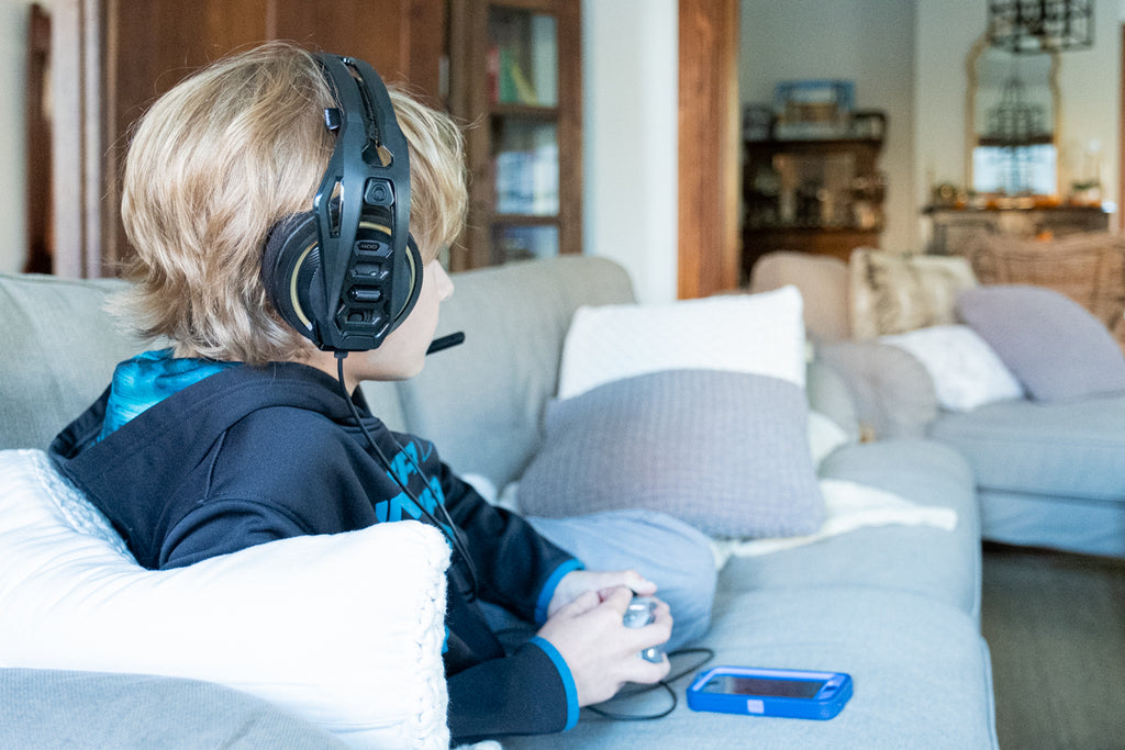 child playing video games with headset
