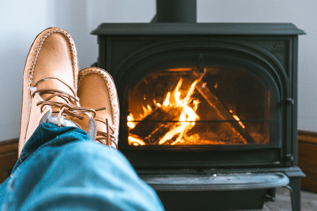 cozy moccasin boots by the fire
