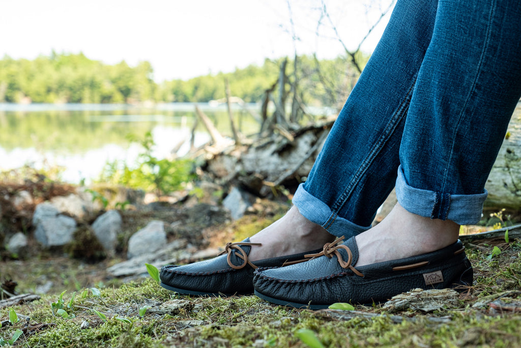 wearing soft sole moccasins outdoor on natural terrain