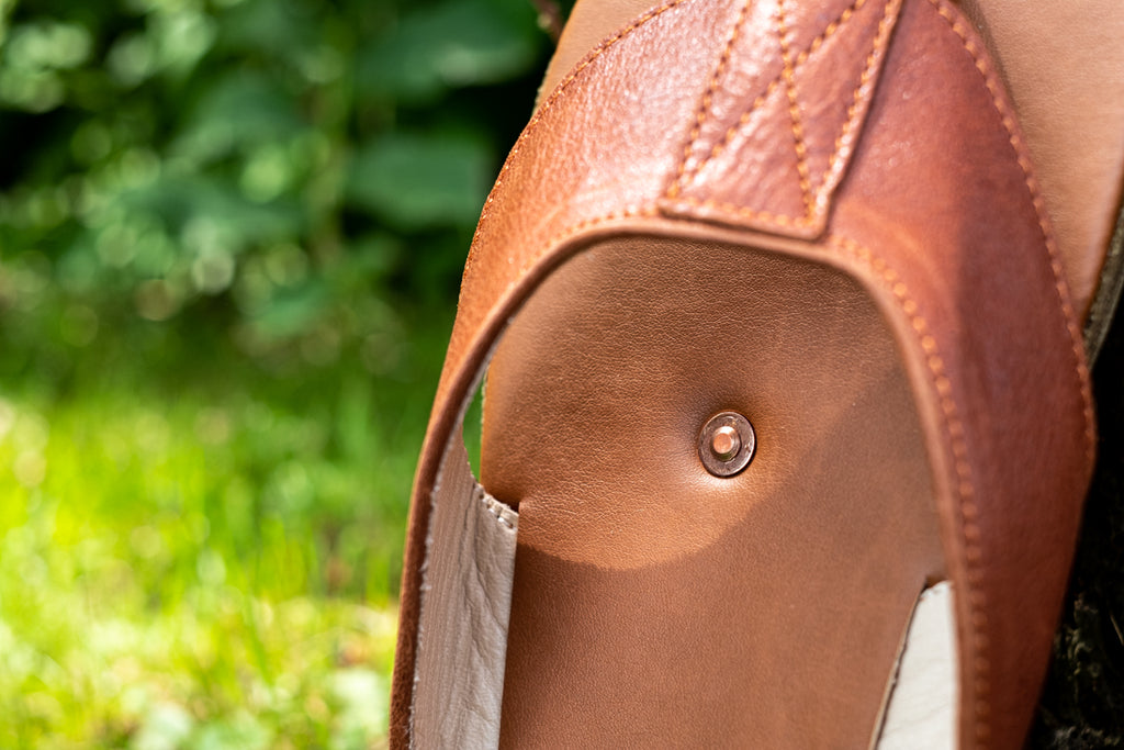 copper rivet inserted into the soles of sandals for earthing