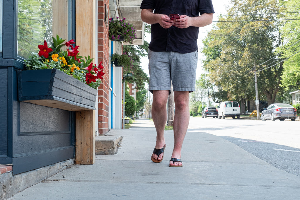 enjoying a summer stroll in cute down town with earthing sandals