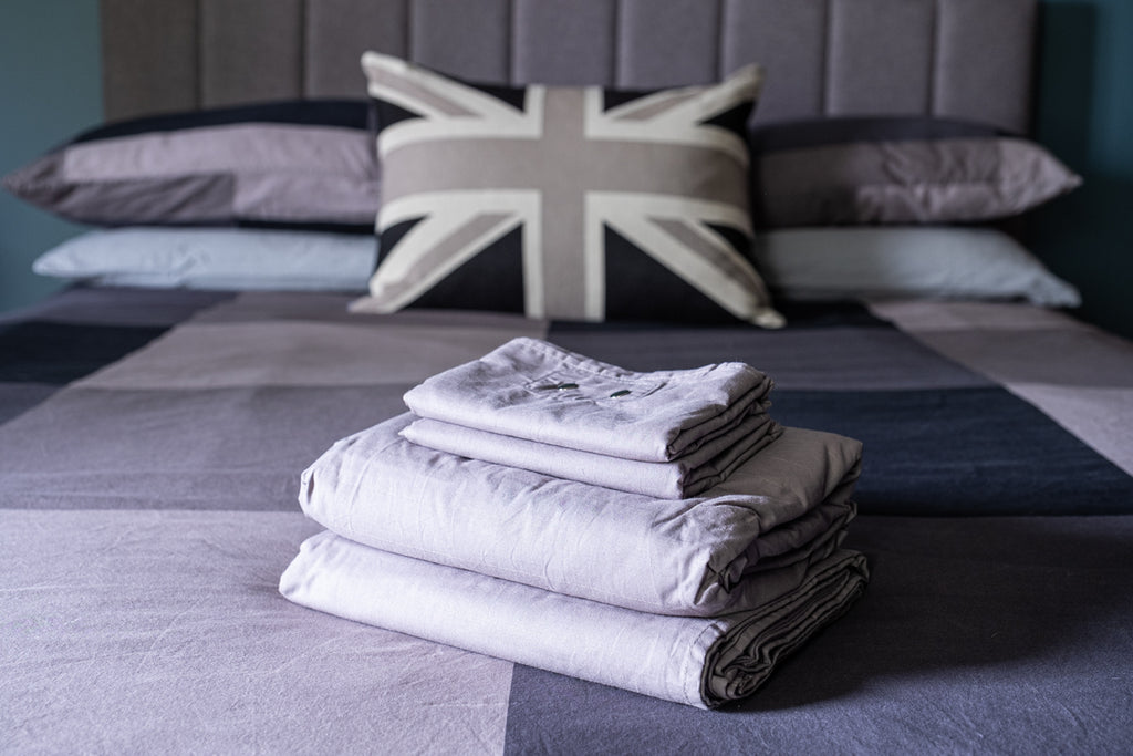 picture of grey sheet set on a bed