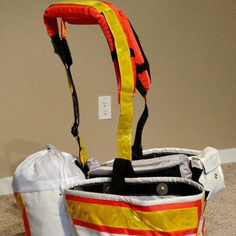 Side of high visibility harness with planting bags