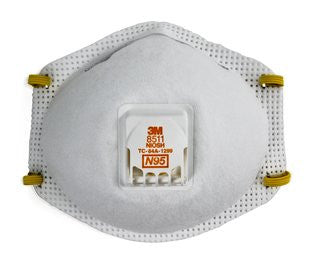 Front view of white disposable respirator.