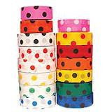 Two stacks of polka dotted tape, in various colours.