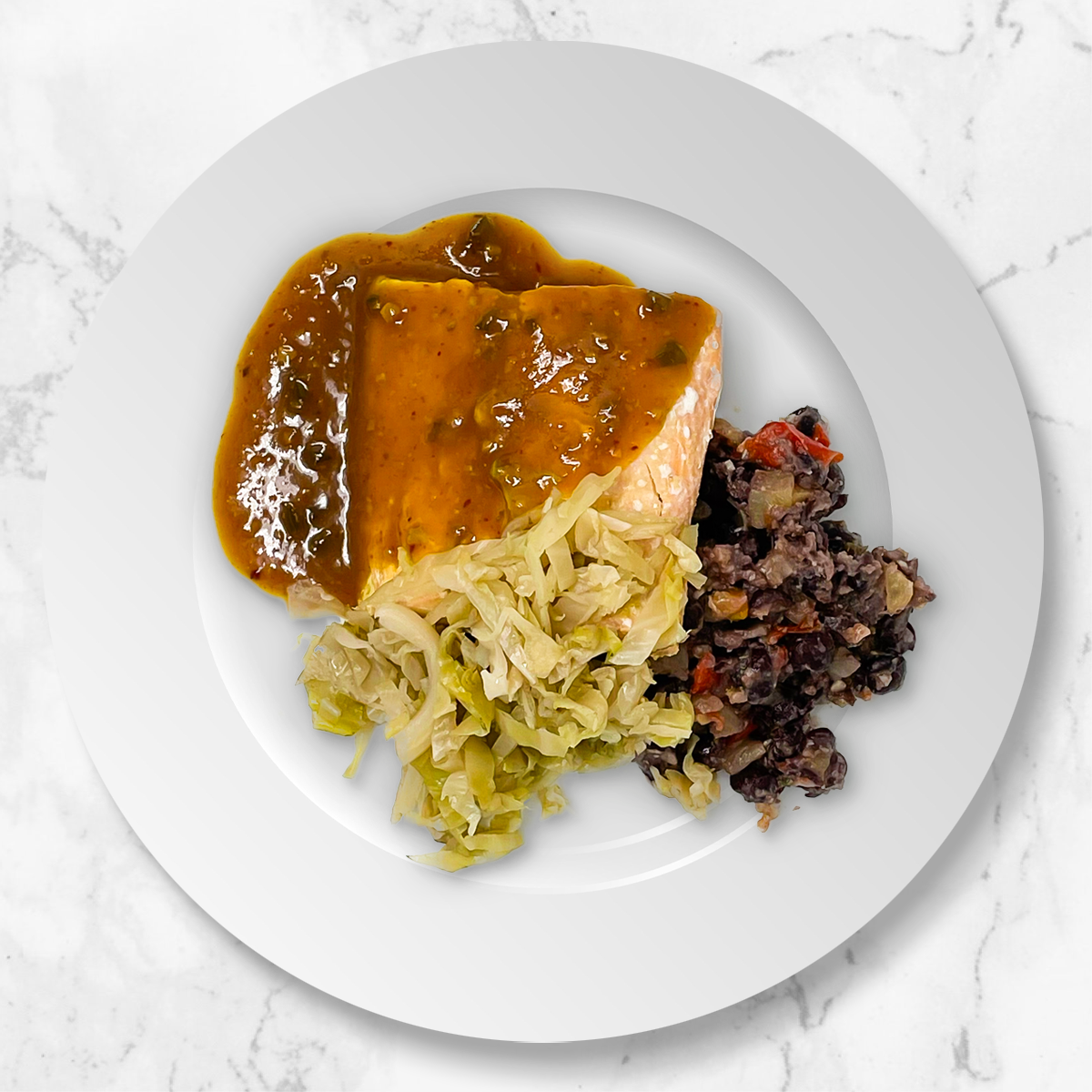 Caribbean Salmon With Refried Black Beans and Spiced Cabbage