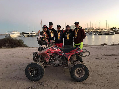 Team 109A posing for a picture after taking 2nd place at the 50th Baja 1000 in the Sportsman ATV Class