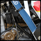 DEI Fire Sleeve shown covering Husqvarna fuel line