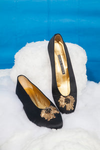 Andrea Pfister black ballerina-like shoes with small heel and golden detail