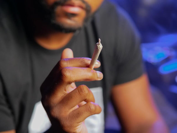 Man holding sealed blunt cone