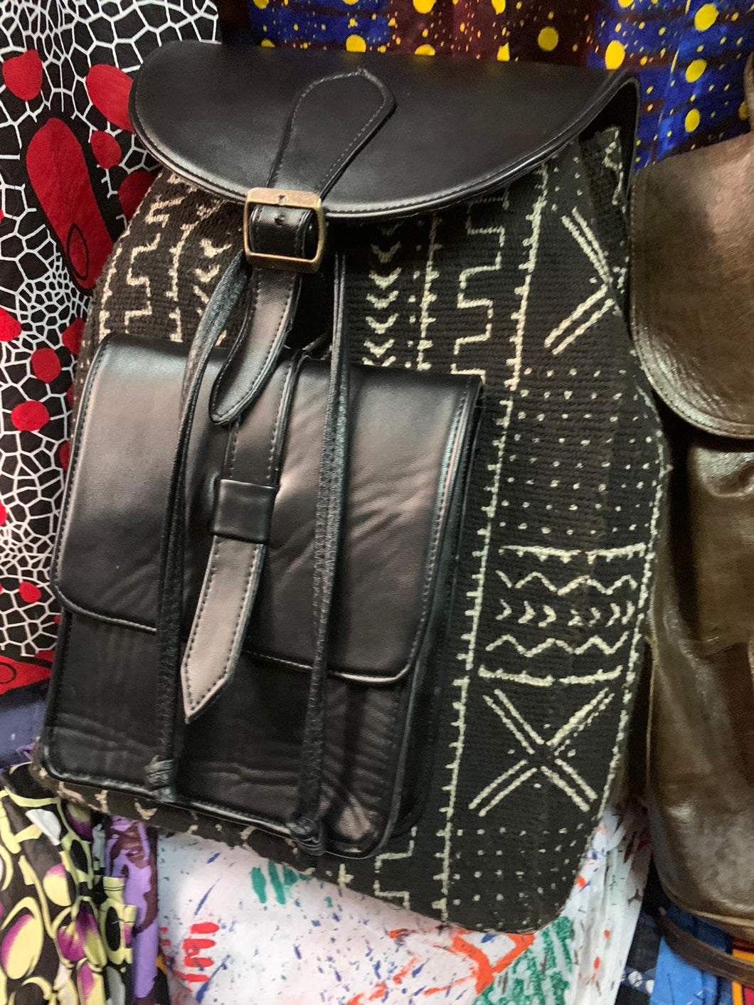 Black Leather & Mudcloth Backpacks