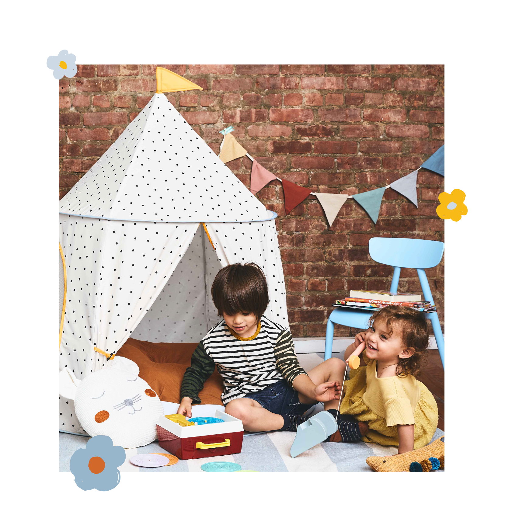 polka dot tent with two kids a little boy and girl playing in front with vintage toys