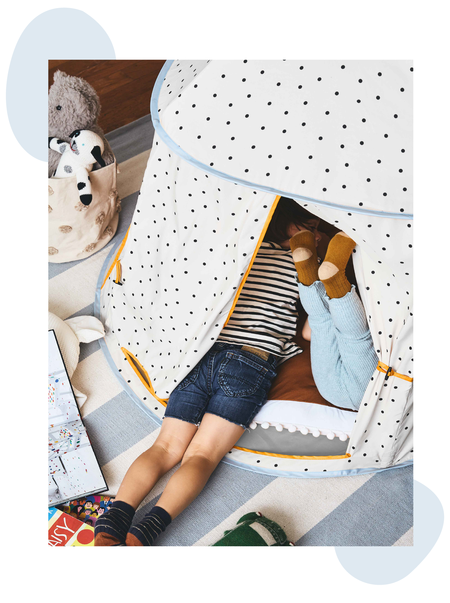 two kids in the polka dot play tent playing