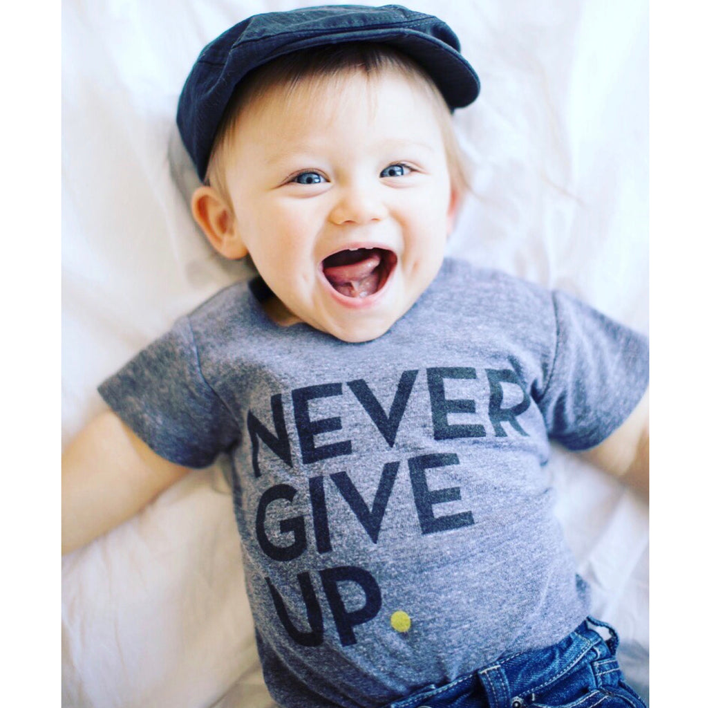 BABY NEVER GIVE UP. ONESIE