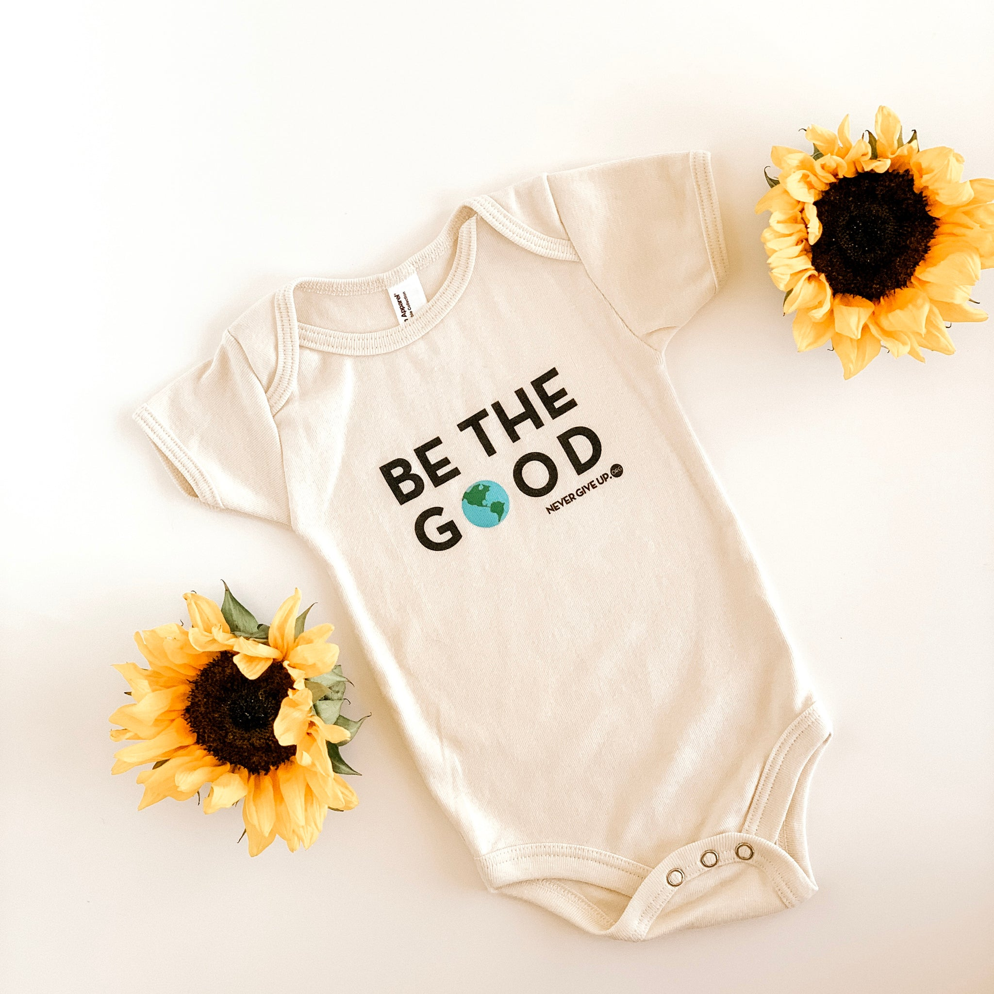 BE THE GOOD. BABY ONESIE