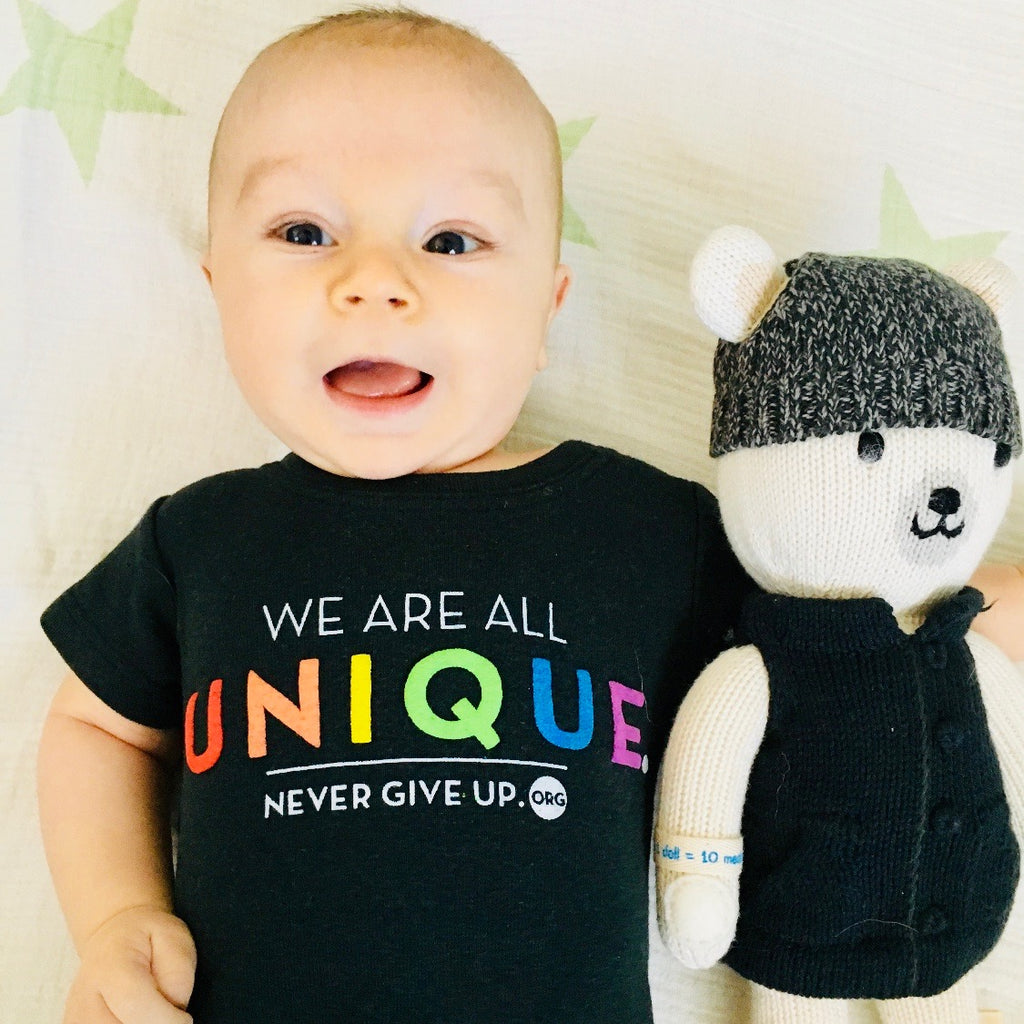 BABY WE ARE ALL UNIQUE ONESIE