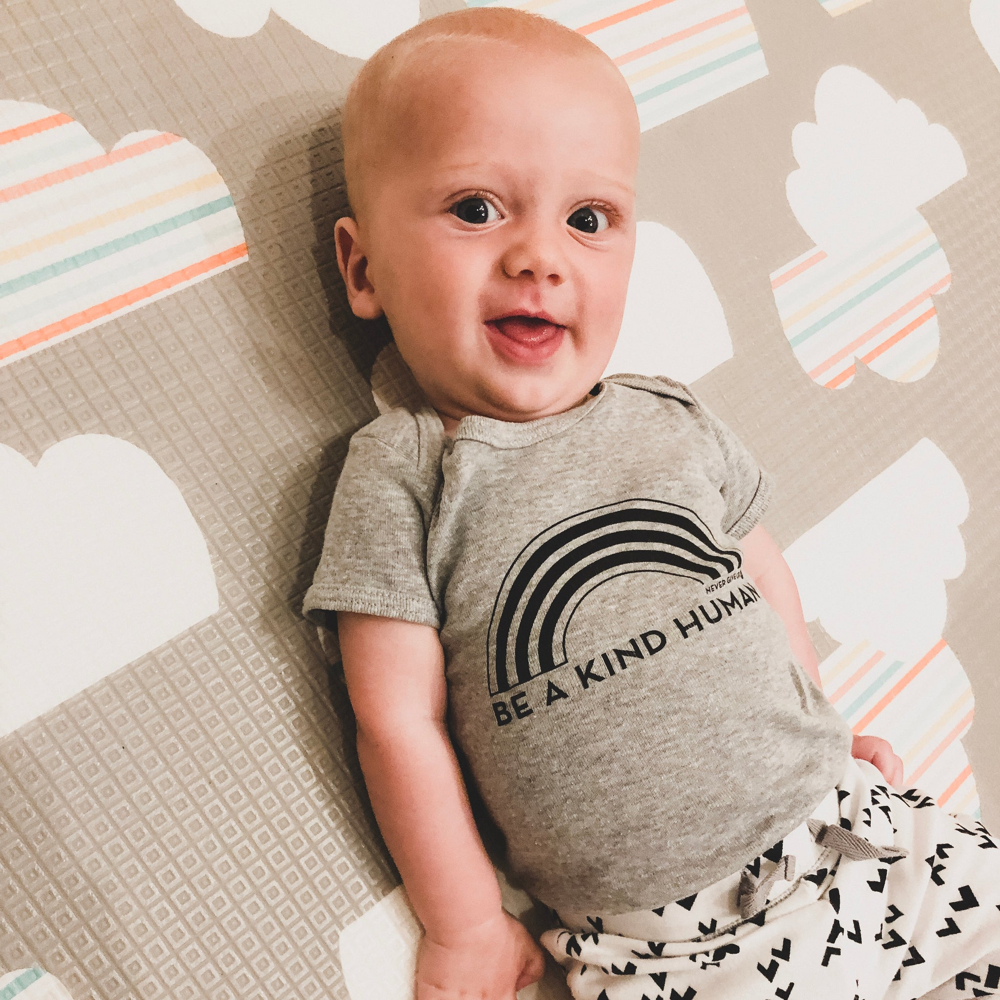 BE A KIND HUMAN BABY ONESIE