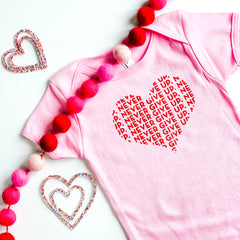 BABY HEART NEVER GIVE UP. ONESIE